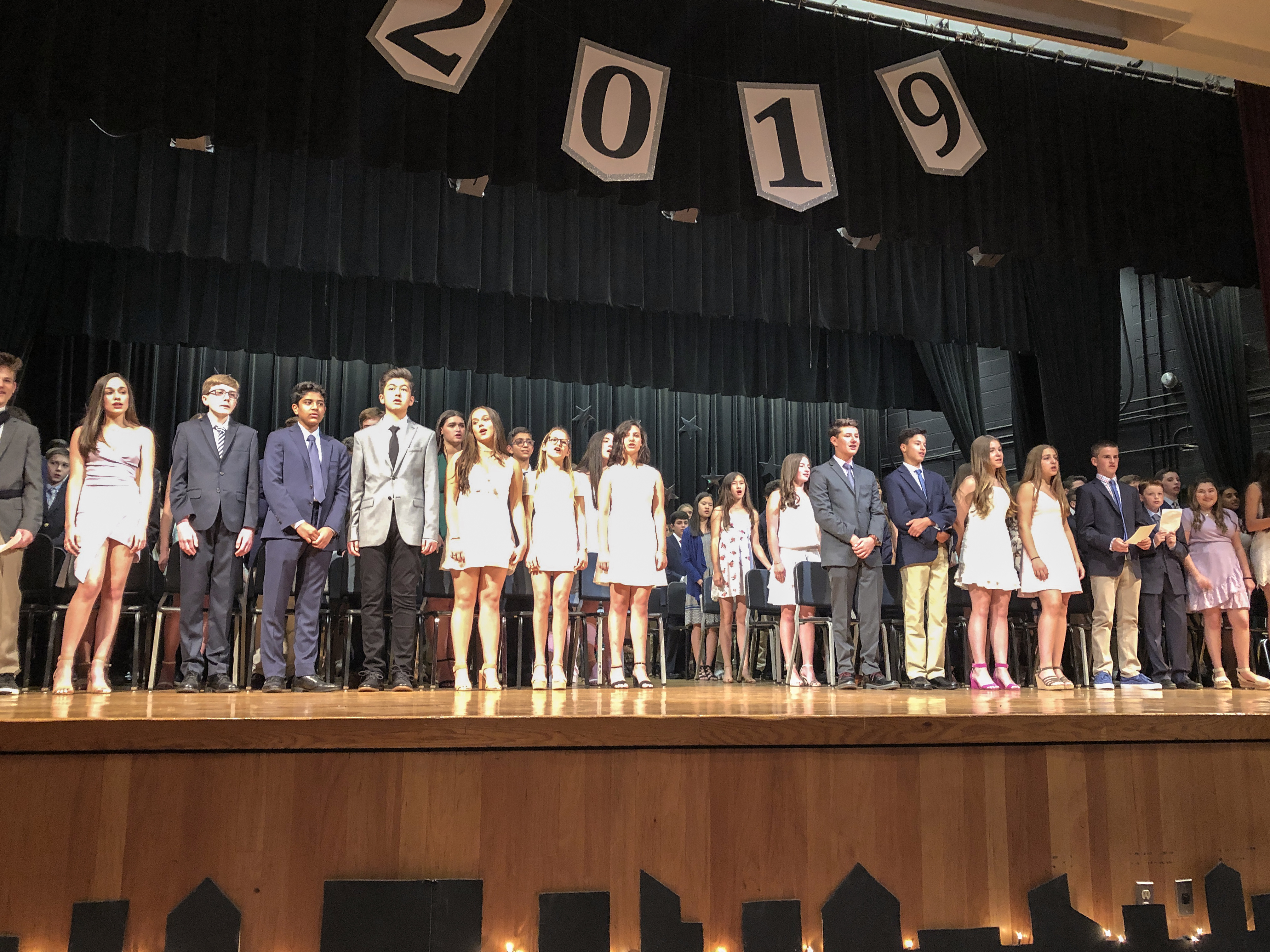 H. C. Crittenden eighth graders shine on stage during their Moving Up Ceremony.