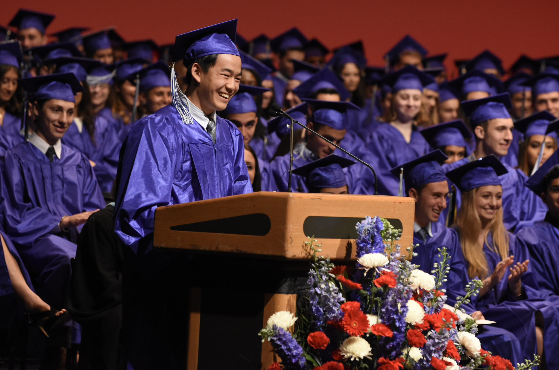 Valedictorian Alan Chang addresses the crowd and his class.