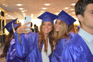 Students at Graduation taking selfie
