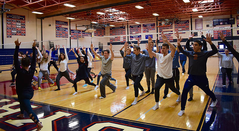 Students participate in a yoga workshop during Byram Hills High School Wellness Day.