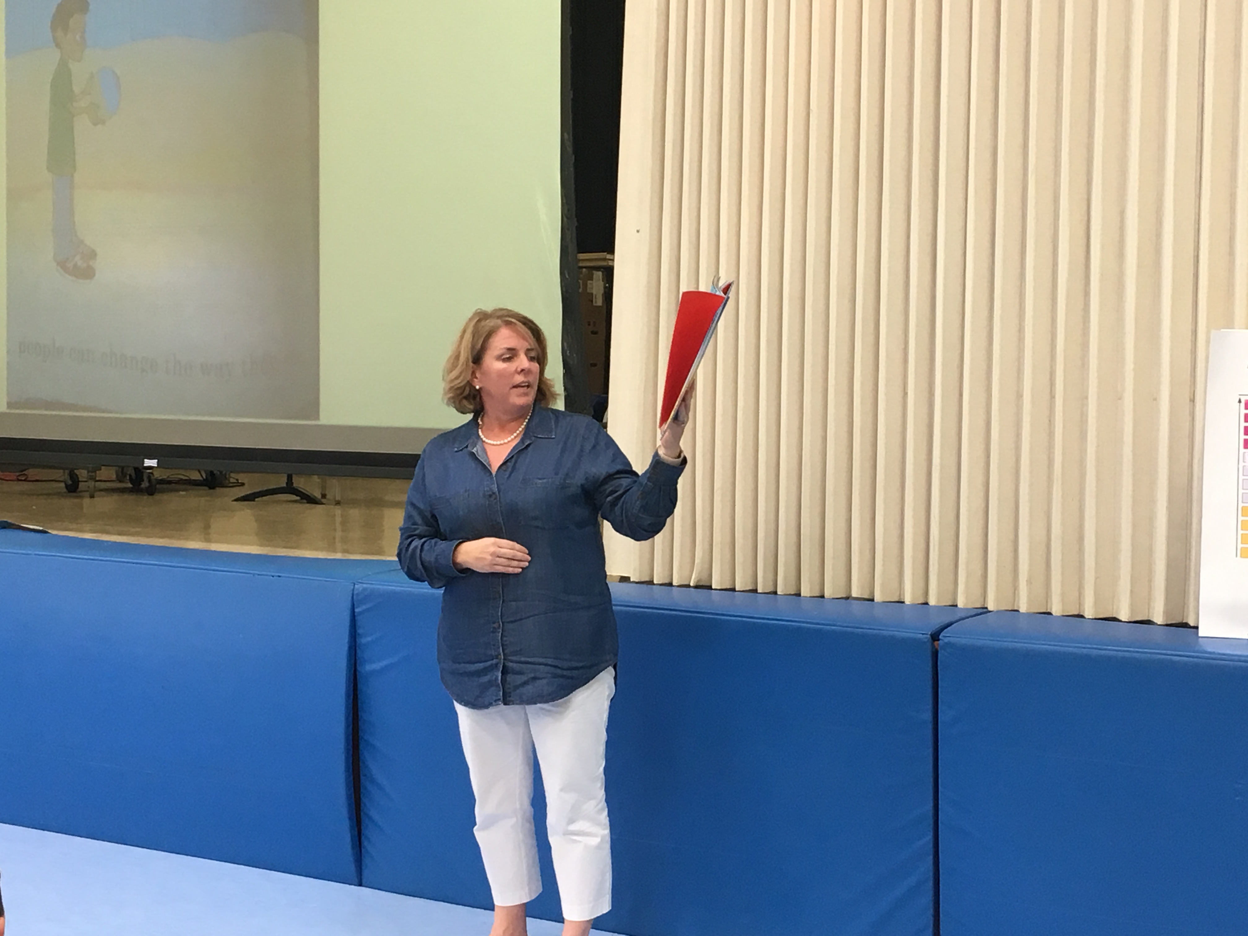 "Wampus Elementary School Principal Peggy McInerney reads ""We're all Wonders"" to students and faculty during the schoolwide community meeting in October."